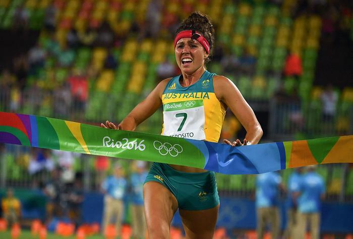 Australia's Chloe Esposito crosses the line to win the modern pentathlon at Rio 2016